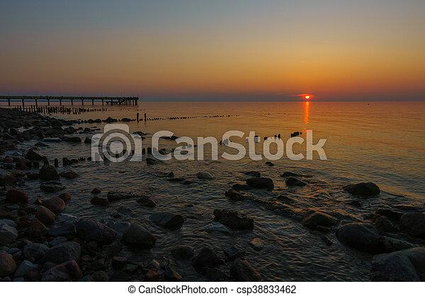 Sunset on Baltic sea coast - csp38833462