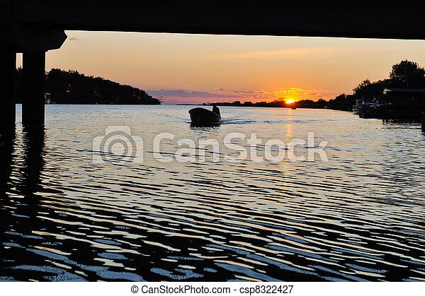 sunset on river - csp8322427