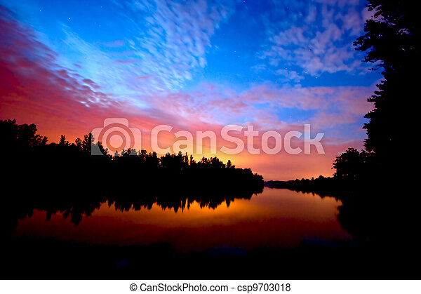 sunset on river - csp9703018