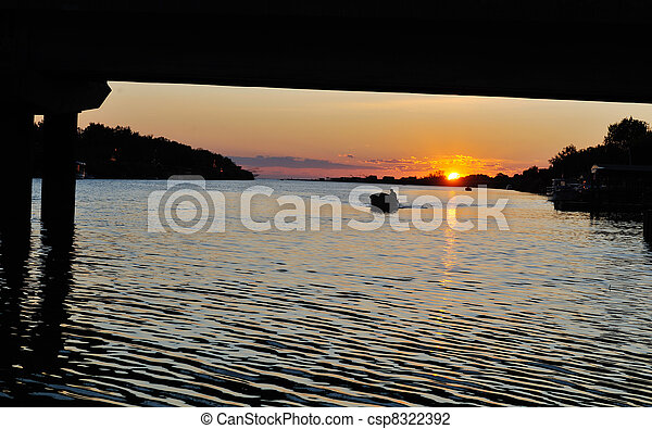 sunset on river - csp8322392