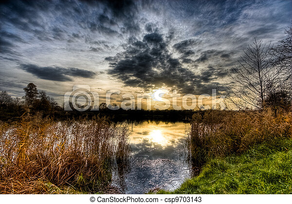 sunset on river - csp9703143