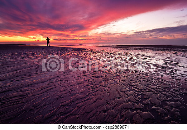 Sunset on the beach in the Netherlands - csp2889671