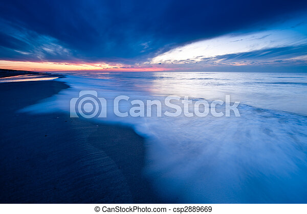 Sunset on the beach in the Netherlands - csp2889669