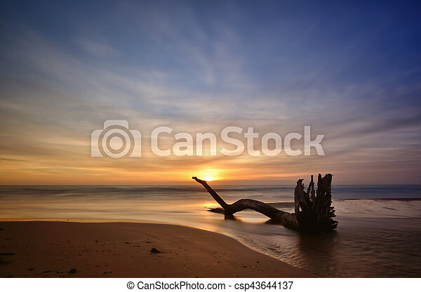 Sunset on the beach, long exposure - csp43644137