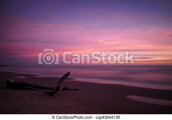 Sunset on the beach, long exposure - csp43644138