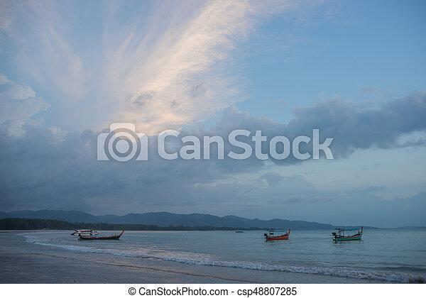 sunset on the beach of andaman sea - csp48807285