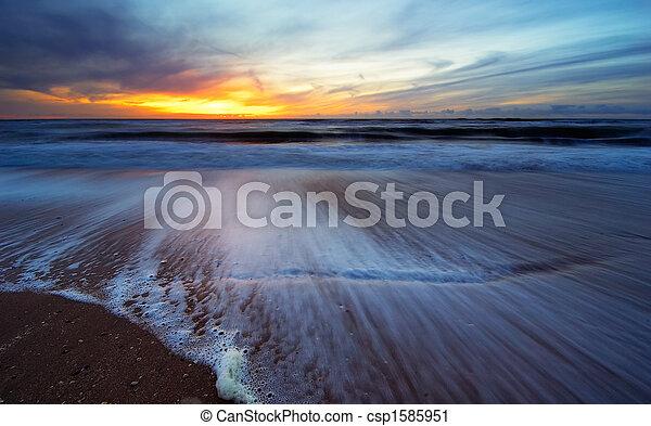 sunset on the beach - csp1585951