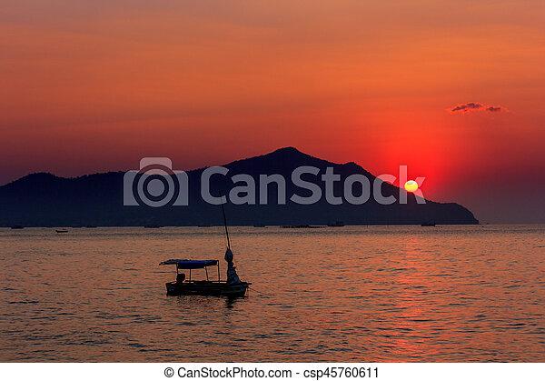 Sunset on the beach. - csp45760611