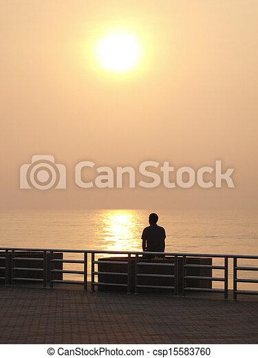 Sunset on the beach - csp15583760