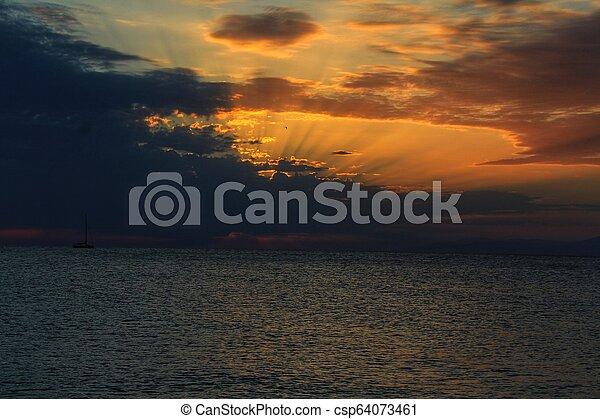 Sunset on the beach - csp64073461