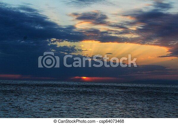 Sunset on the beach - csp64073468