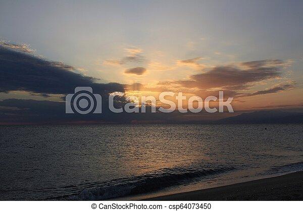 Sunset on the beach - csp64073450