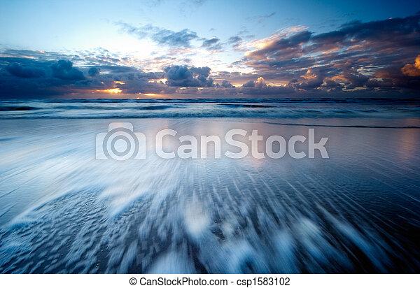 sunset on the beach - csp1583102