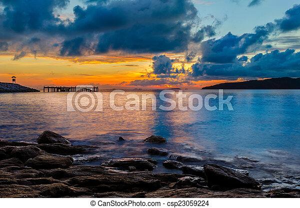 Sunset on the beach - csp23059224