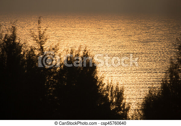 Sunset on the beach. - csp45760640