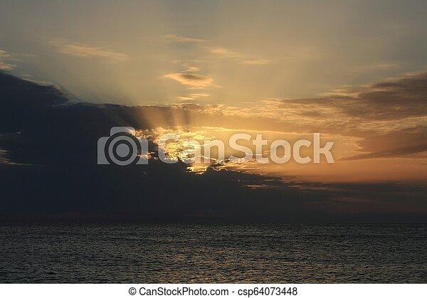 Sunset on the beach - csp64073448