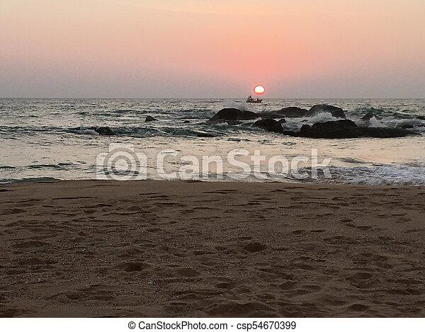 Sunset on the beach - csp54670399