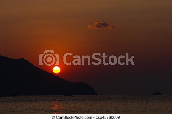 Sunset on the beach. - csp45760609