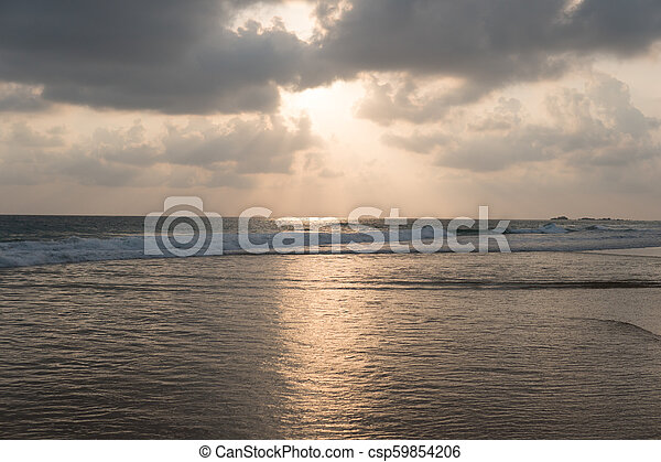 Sunset on the beach - csp59854206