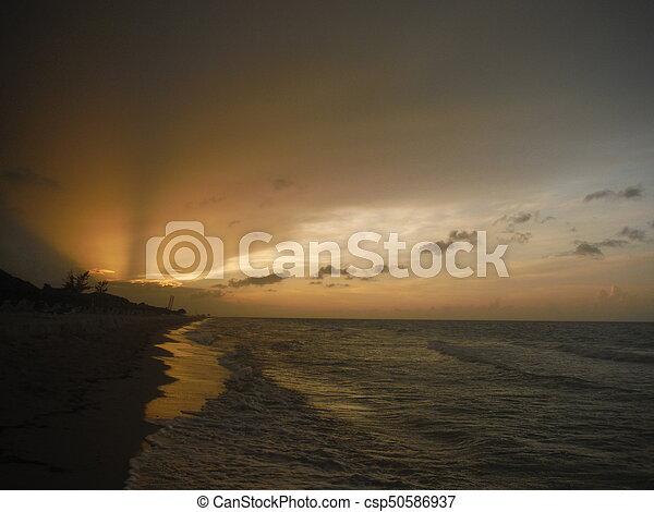 Sunset on the beach - csp50586937