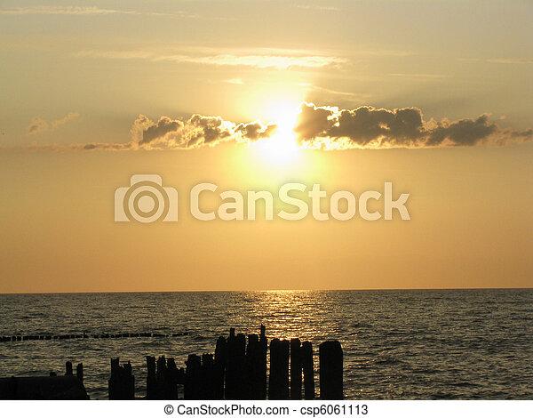 sunset on the beach - csp6061113
