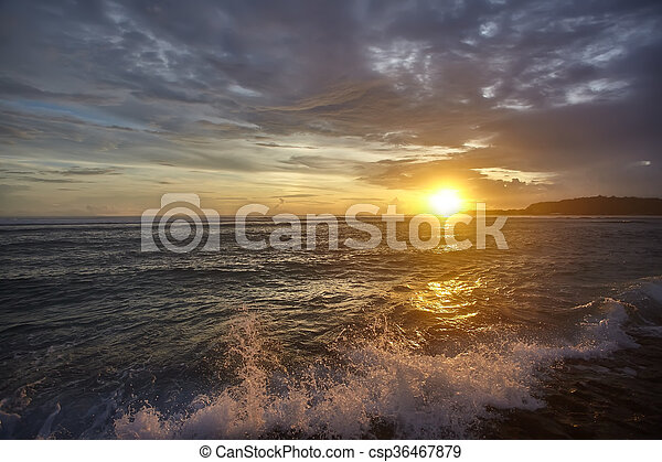 Sunset on the beach with beautiful sky - csp36467879