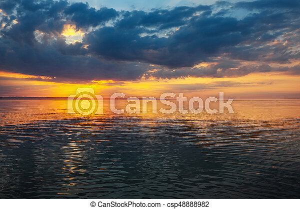 Sunset on the beach with beautiful sky. - csp48888982