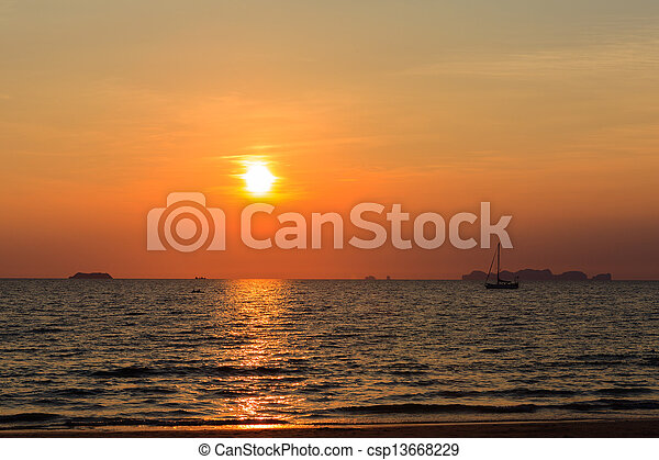 Sunset on the beach with boat - csp13668229