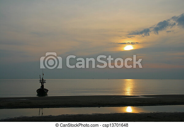 Sunset on the beach with boat - csp13701648