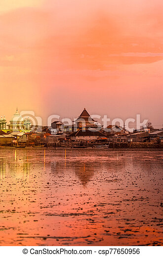 sunset on the beach with orange background in kenjeran beach surabaya east java indonesia can stock photo