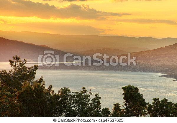 Sunset on the lake - csp47537625