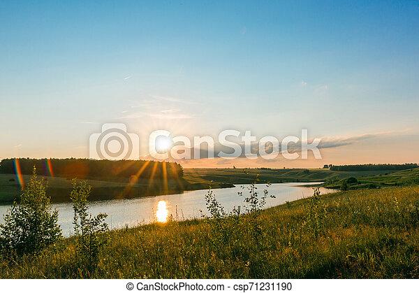 Sunset on the lake. - csp71231190