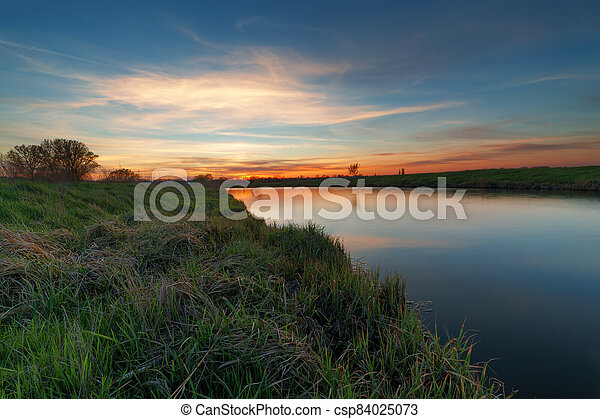 sunset on the river - csp84025073