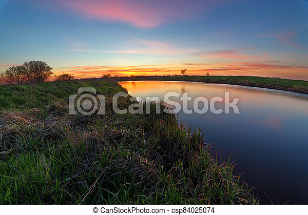 sunset on the river - csp84025074