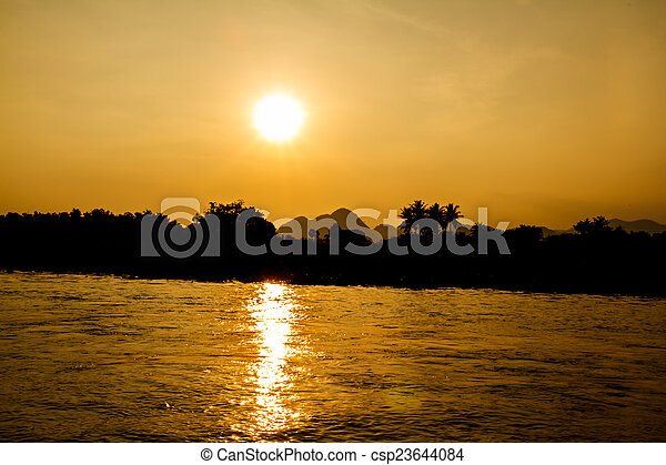 Sunset on the river - csp23644084