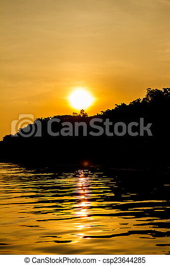Sunset on the river - csp23644285