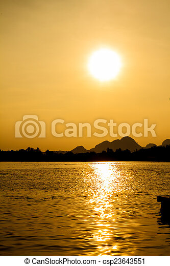 Sunset on the river - csp23643551