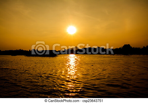 Sunset on the river - csp23643751