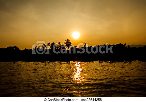 Sunset on the river - csp23644258