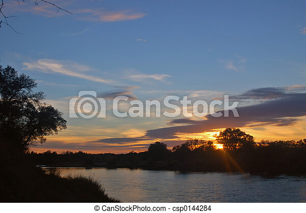 sunset on the river - csp0144284