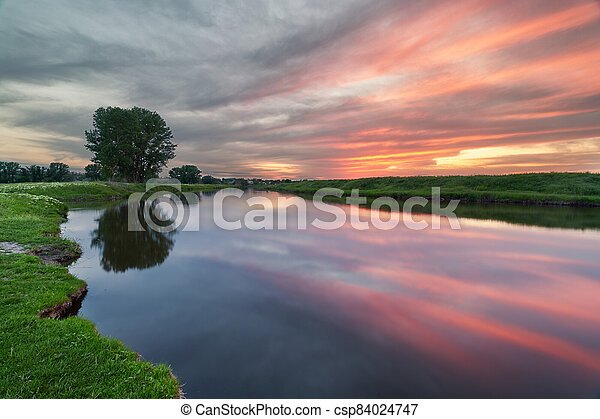 sunset on the river - csp84024747