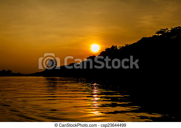 Sunset on the river - csp23644499