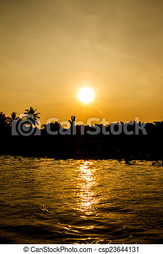 Sunset on the river - csp23644131