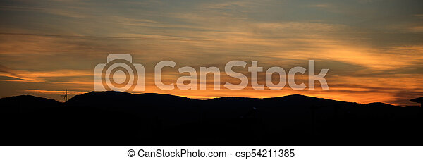 Sunset or sunrise over mountains silhouette with colorful sky background. - csp54211385
