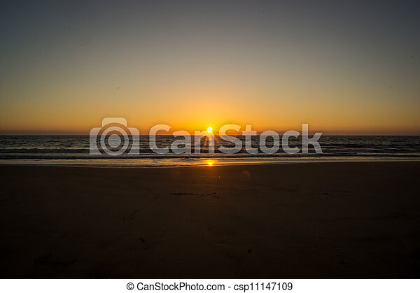 Sunset over a beach - csp11147109