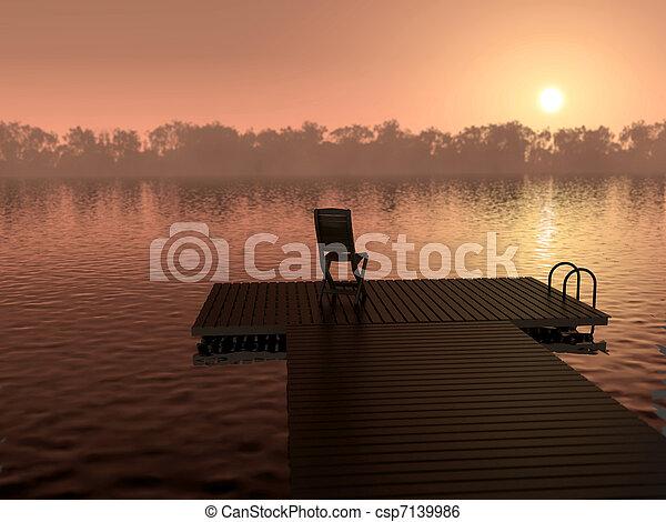 Sunset over a calm lake - csp7139986