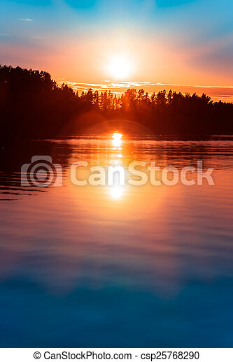 sunset over a lake in northern europe - csp25768290