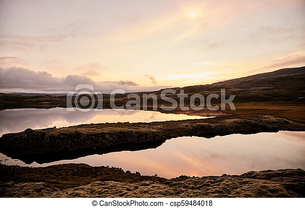 Sunset over a mountain lake in Iceland - csp59484018