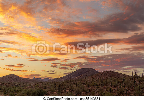Sunset over a mountain landscape in the Sonoran Desert - csp85143661