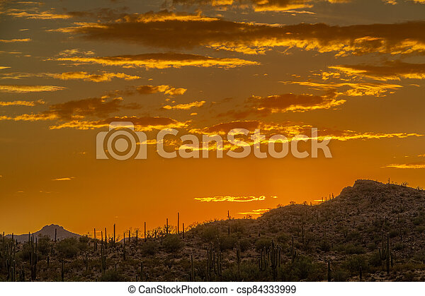 Sunset over a mountain landscape in the Sonoran Desert - csp84333999